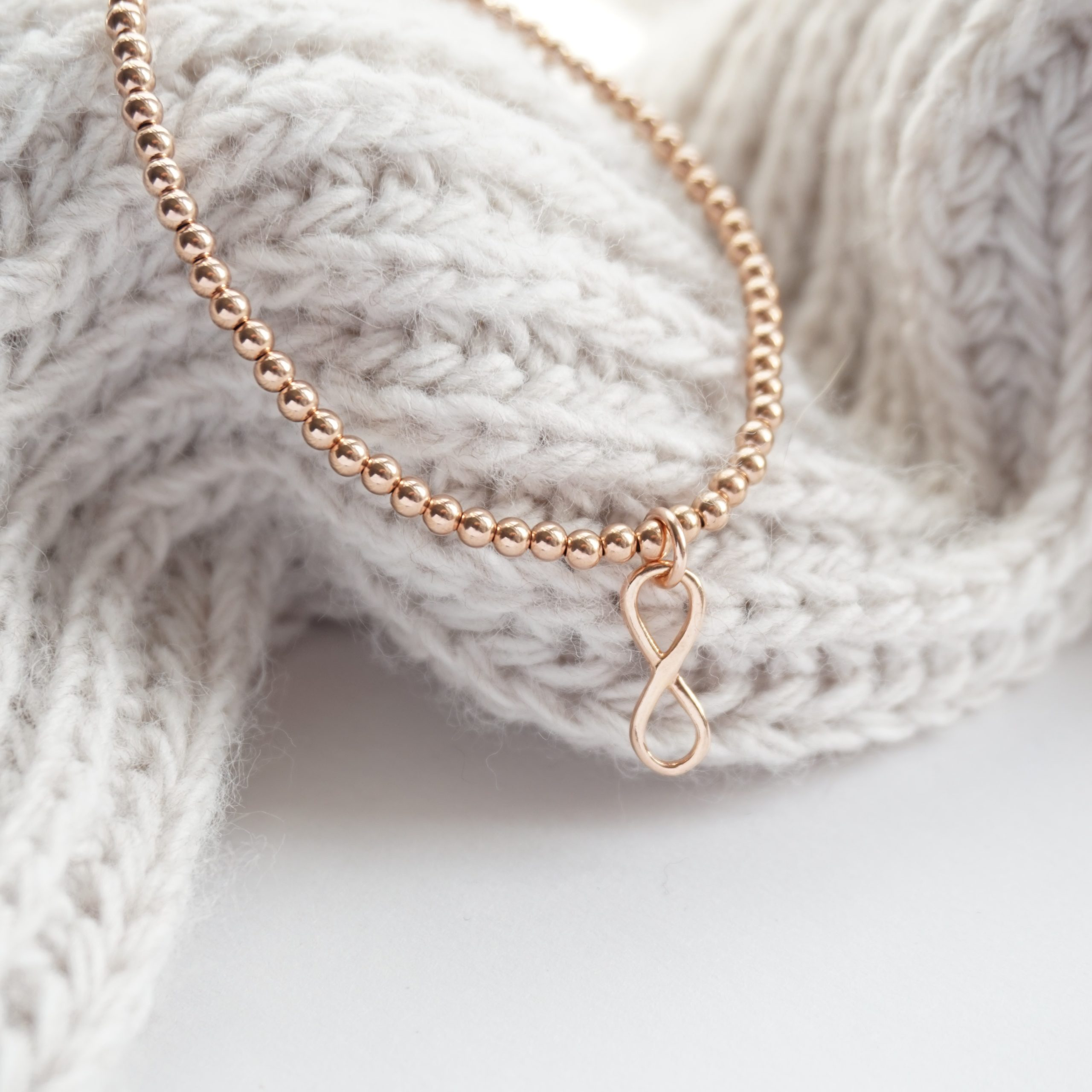 rose gold bracelet with infinity charm