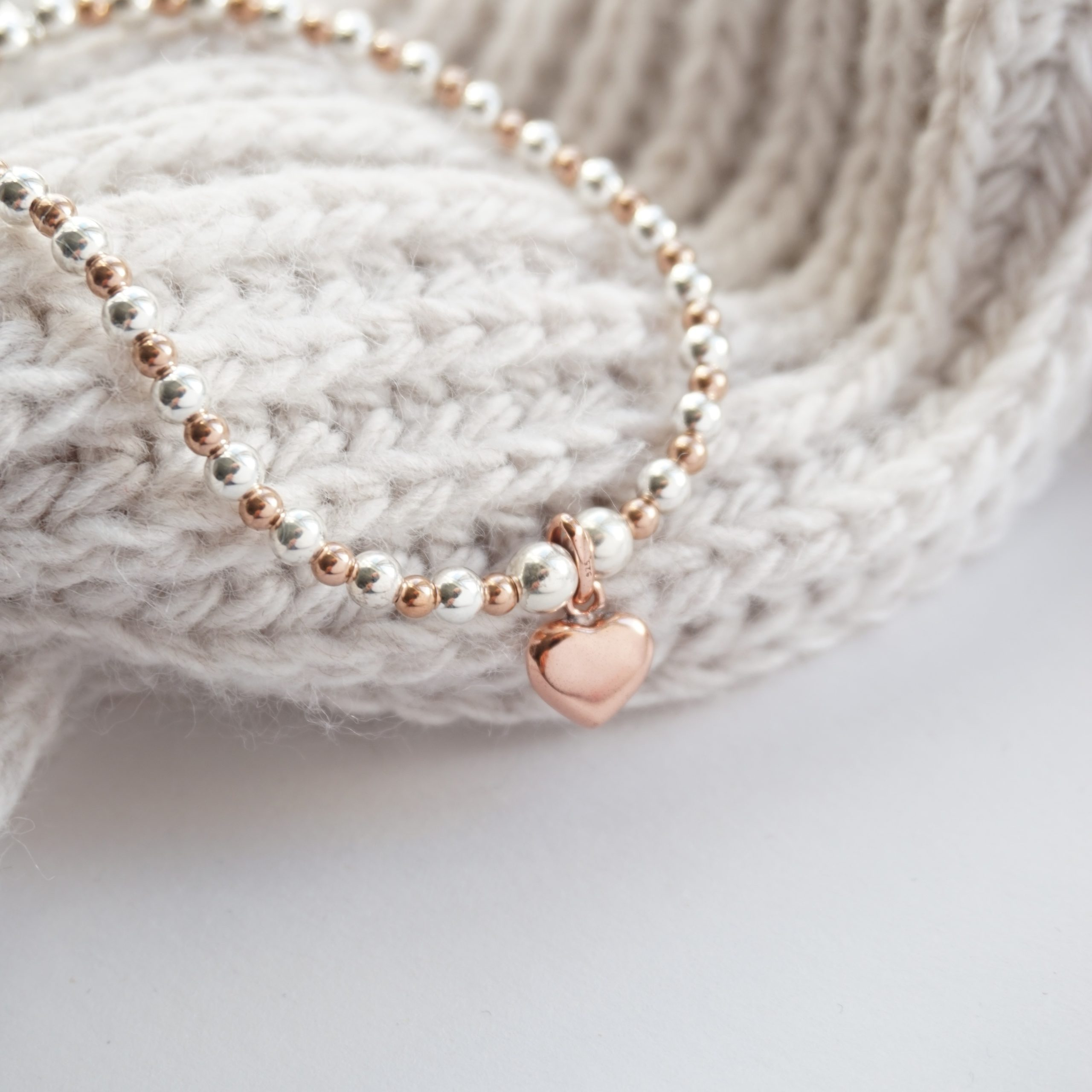 sterling silver and rose gold bracelet with heart charm