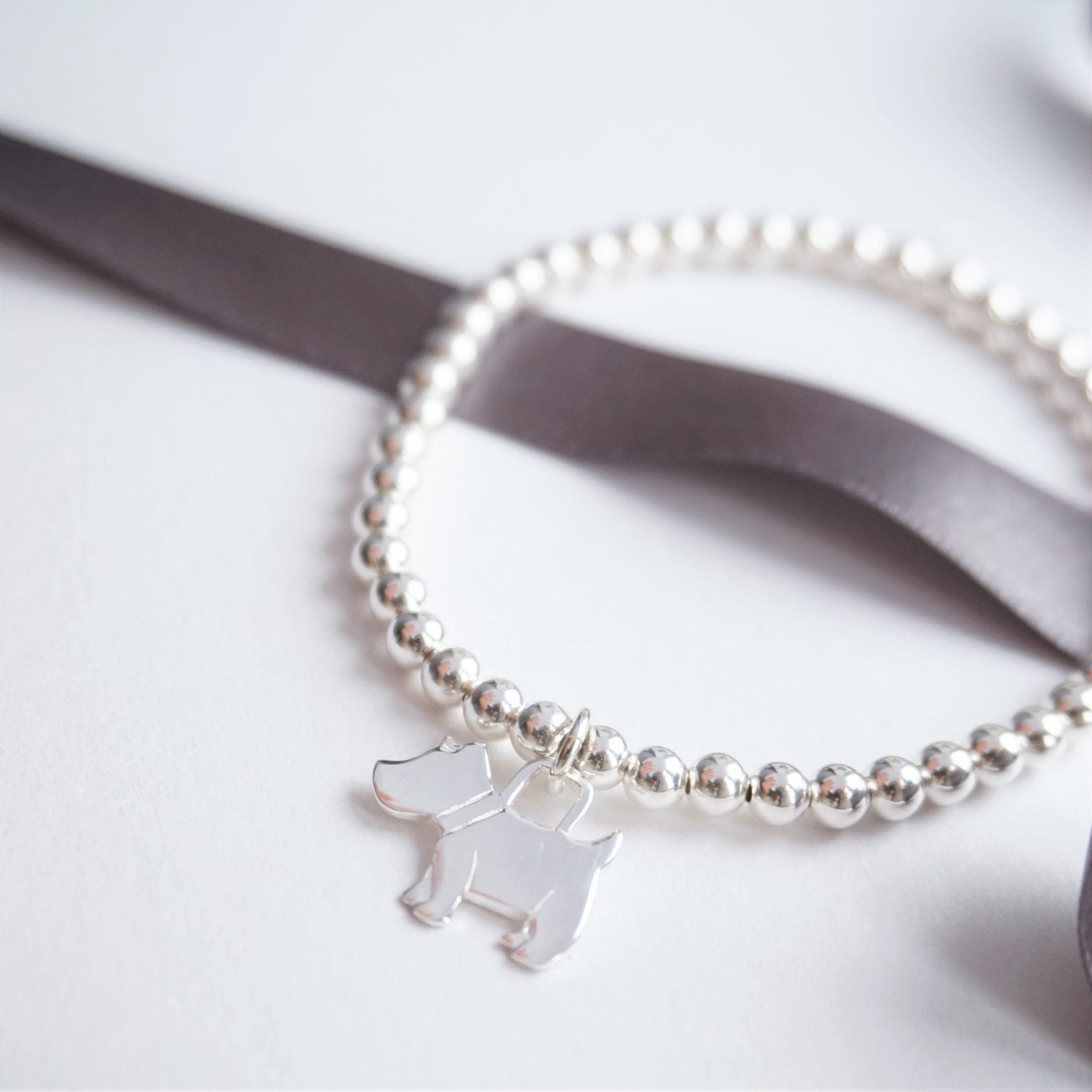 sterling silver bracelet with dog charm