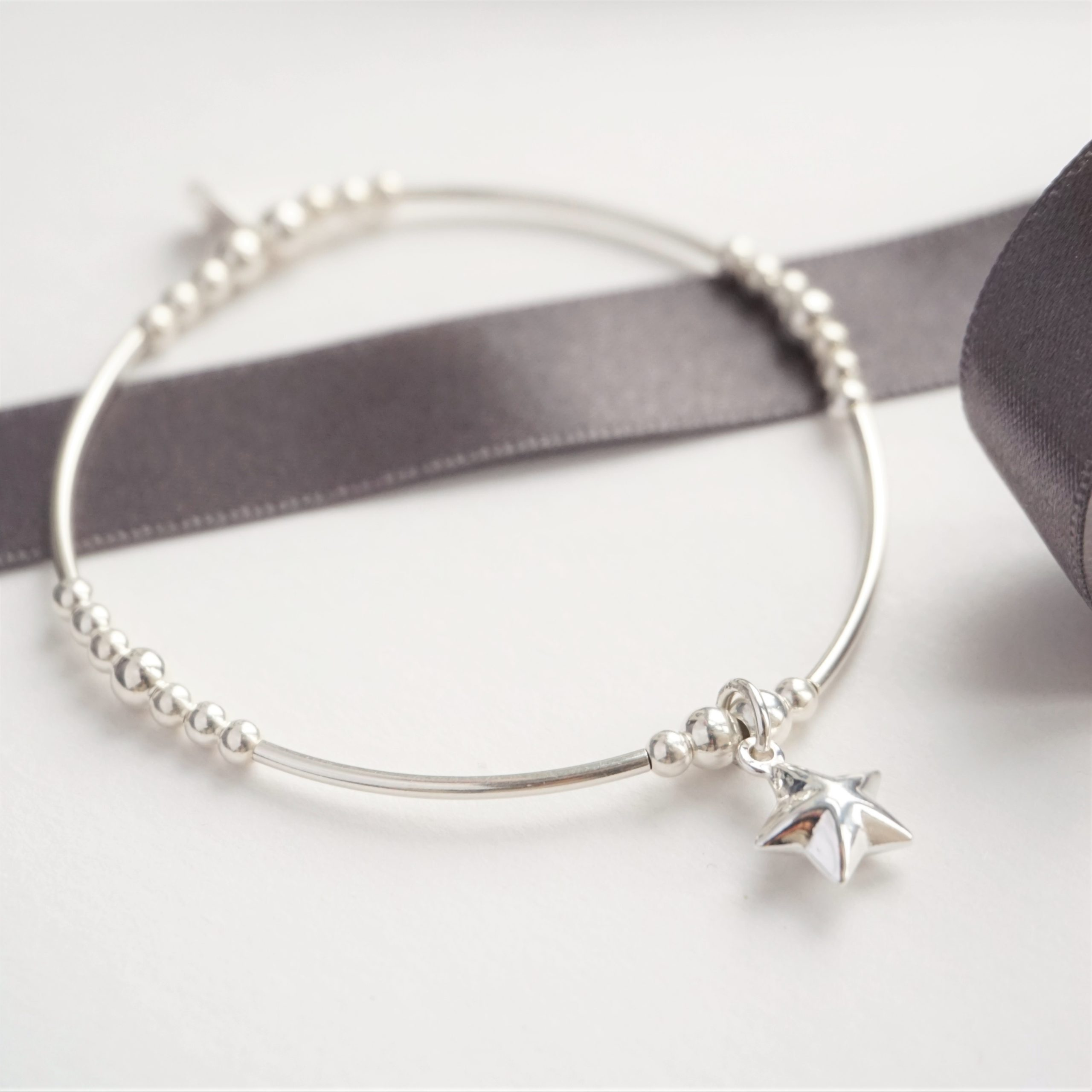 Sterling silver noodle bracelet with star charm