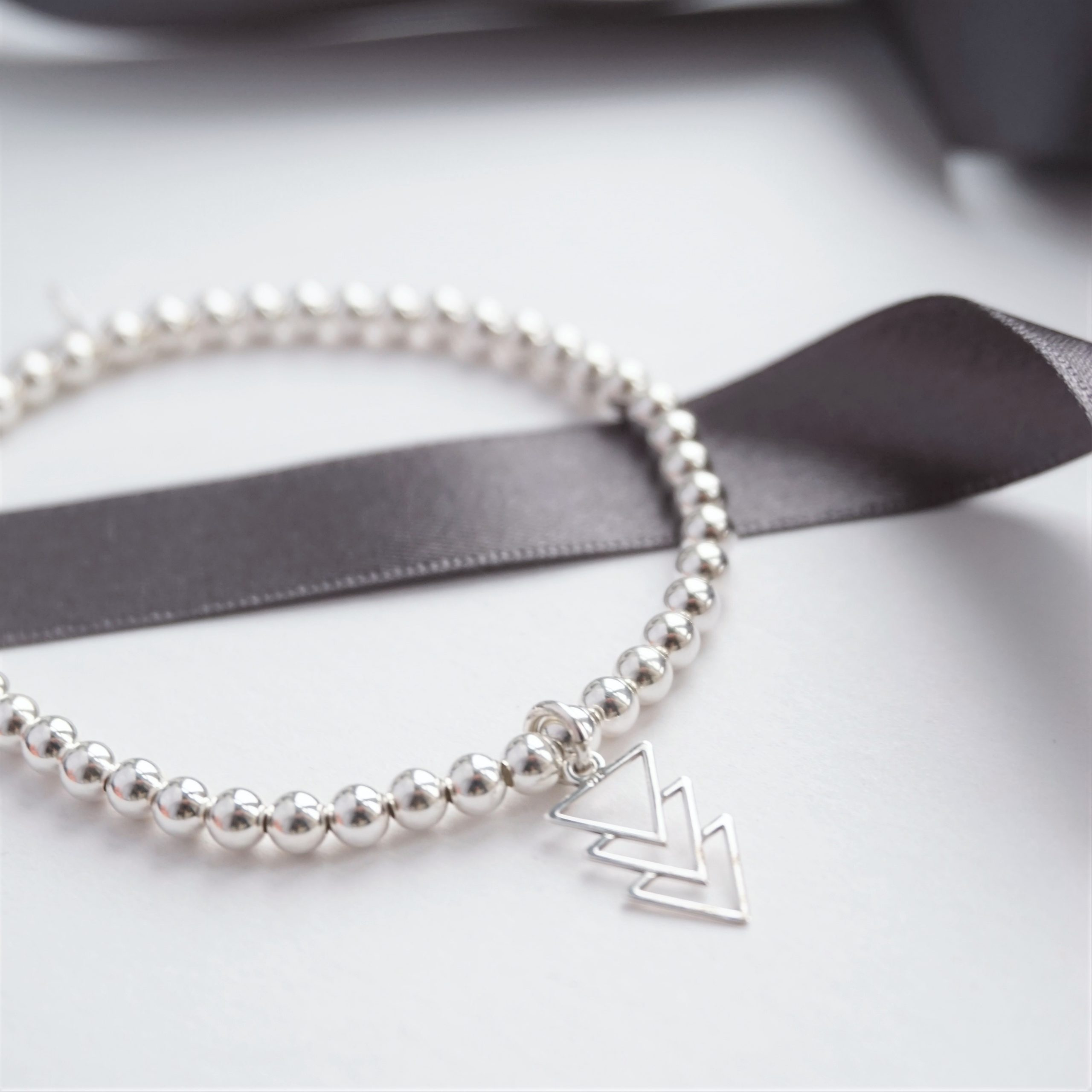 Sterling silver bracelet with triple triangle charm