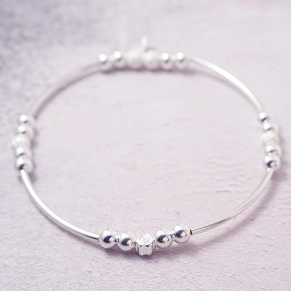 Sterling Silver Stretch Noodle Bracelet with Stardust Beads and Flower Bead