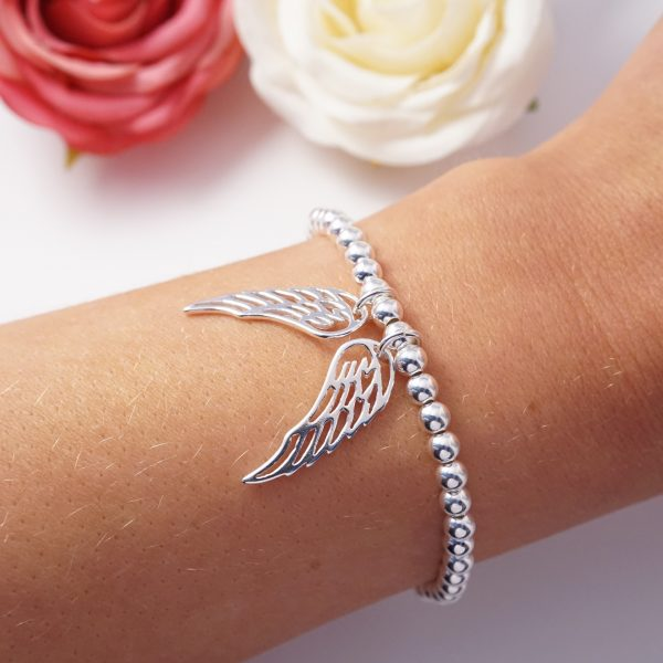 sterling silver bracelet with large angel wing charms