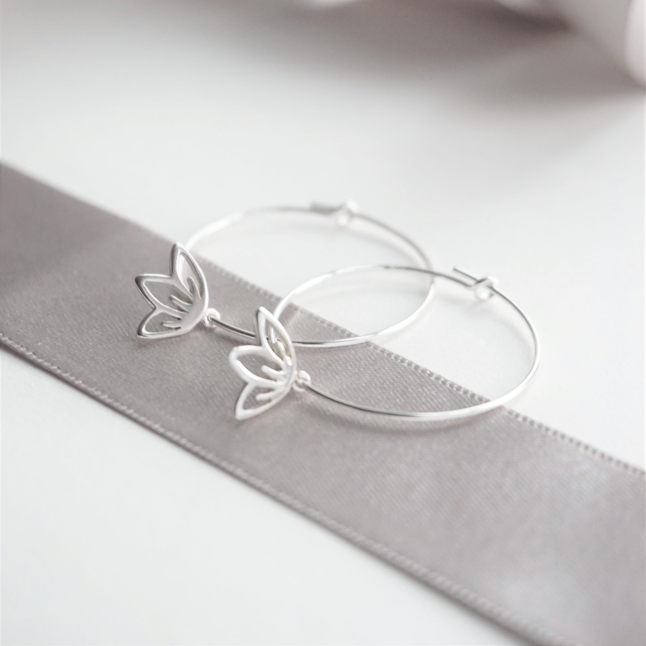 Sterling silver hoop earrings with blossom charms