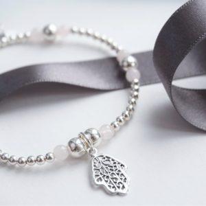 Sterling silver and rose quartz hamsa hand bracelet
