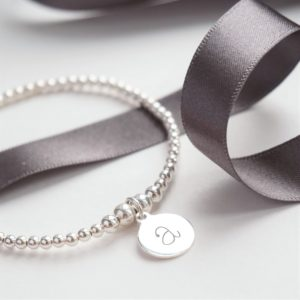 sterling silver bracelet with one lowercase initial charm