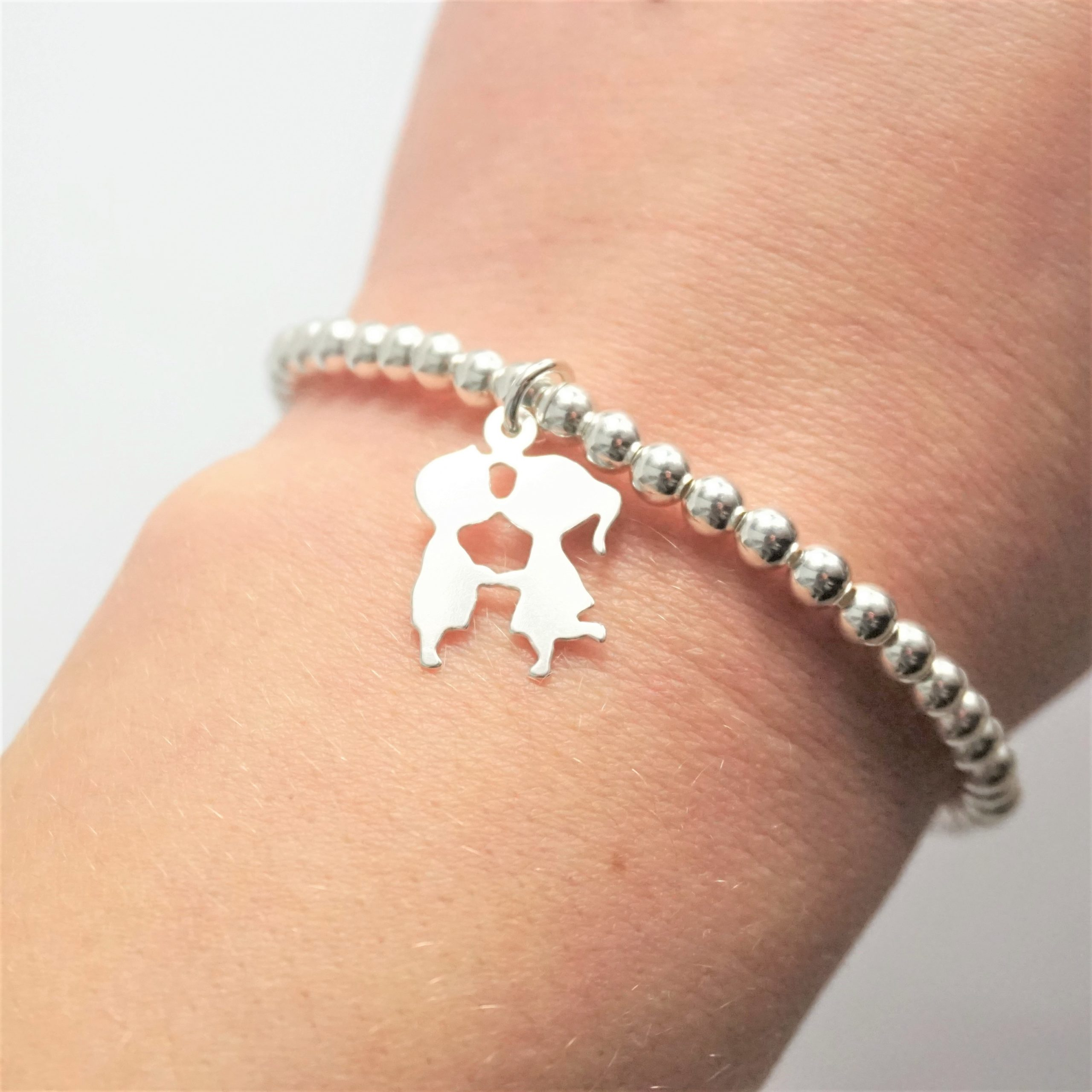 Sterling silver bracelet with kissing couple charm