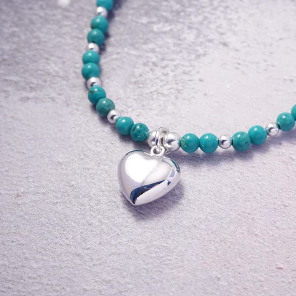 Sterling Silver Stretch Bracelet with Turquoise Beads and Heart Charm