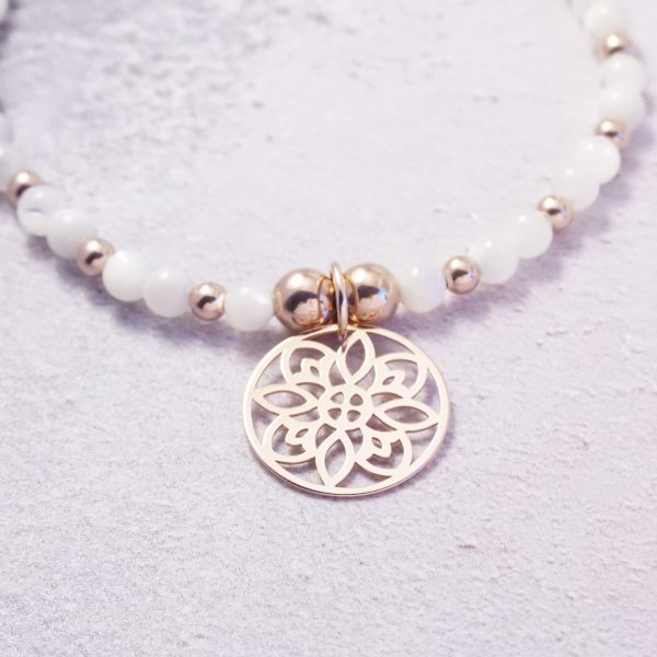 Rose Gold Stretch Bracelet with Mother of Pearl Beads and Circular Design Charm