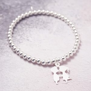 Sterling Silver Stretch Bracelet with Kissing Couple Charm