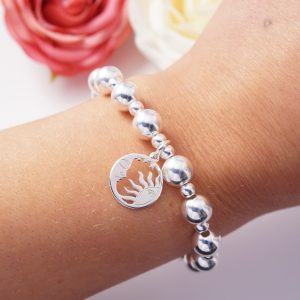 Sterling silver bracelet with sun and moon disc