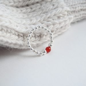 Sterling silver stretch ring with carnelian bead