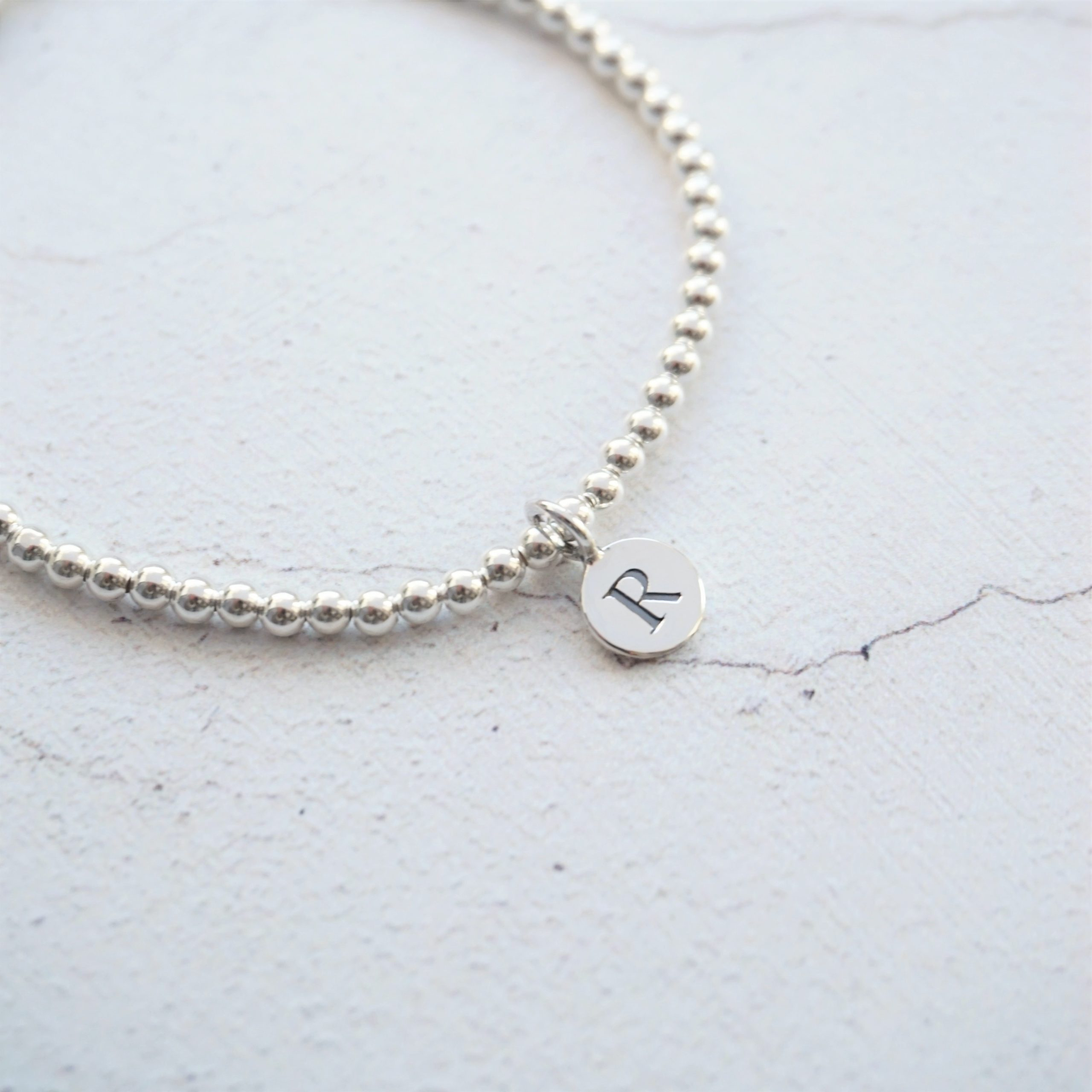 sterling silver bracelet with 1 small disc initial charm