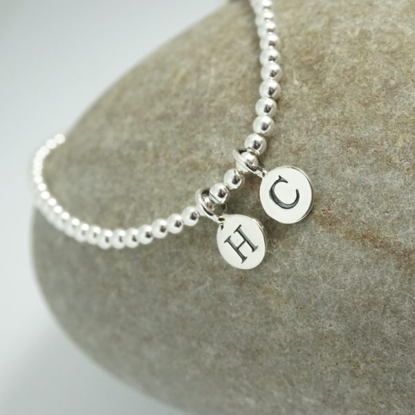 Sterling Silver Stretch Bracelet with Two Small Disc Initial Charms