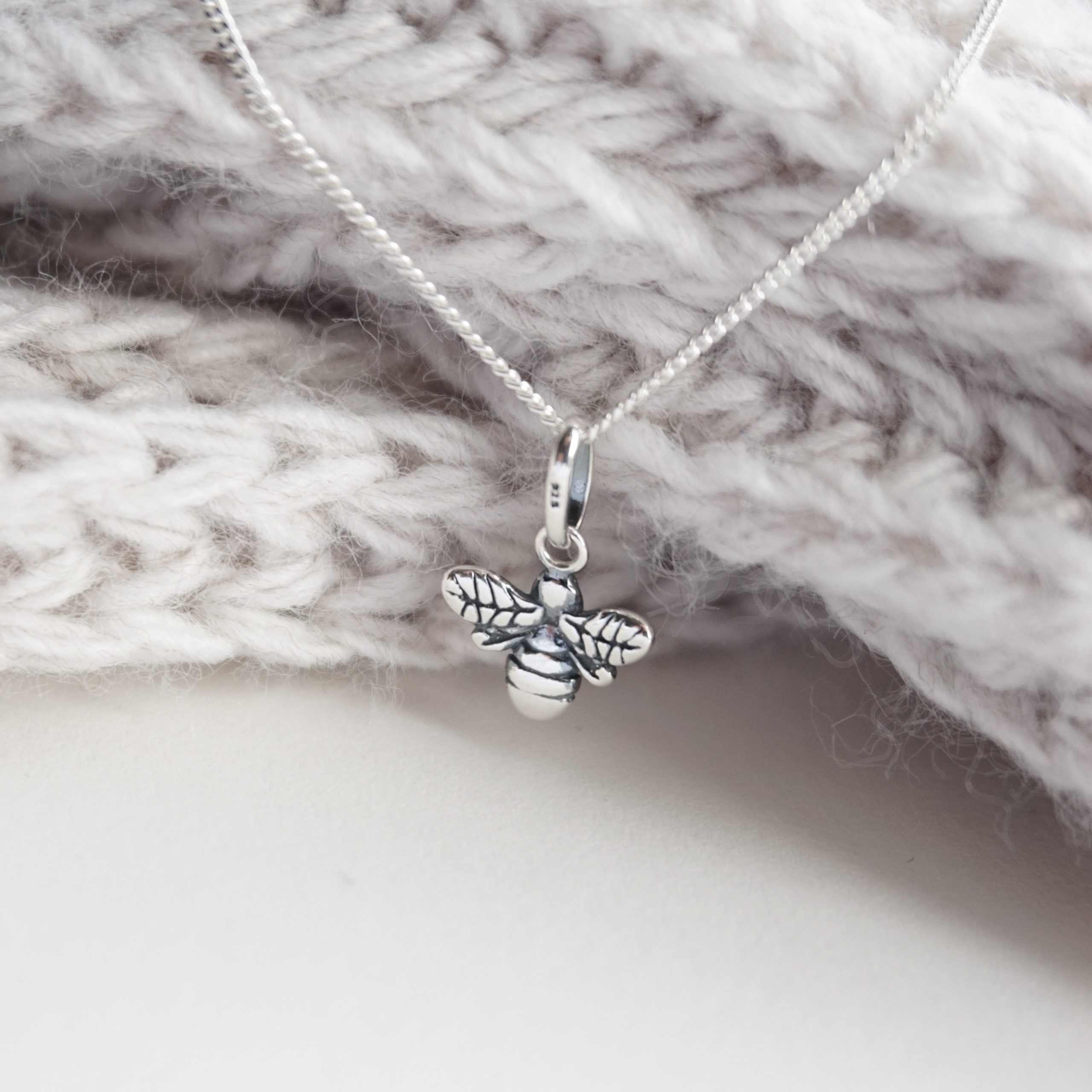 Sterling silver necklace with buzzy bee charm