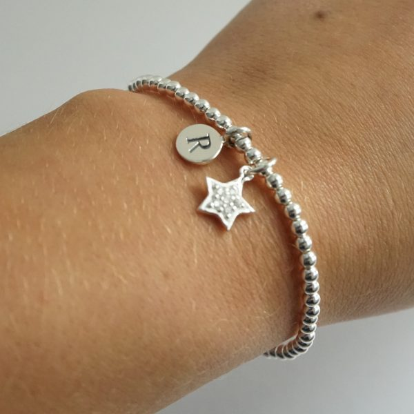 Sterling Silver Stretch Bracelet with One Small Disc Initial Charm and Cubic Zirconia Star Charm
