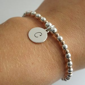 Sterling Silver and Rose Gold Stretch Bracelet with One Lowercase Initial Charm