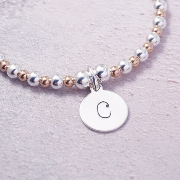 sterling silver and rose gold initial bracelet