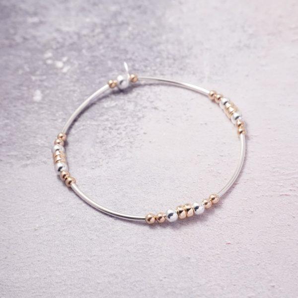 sterling silver and rose gold noodle bracelet