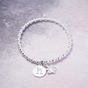 sterling silver initial disc bracelet with paw