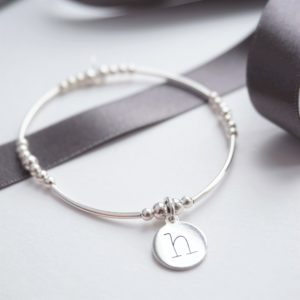 sterling silver noodle bracelet with lowercase initial