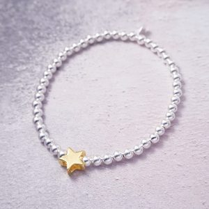 Sterling Silver Stretch Bracelet with Gold Star Bead