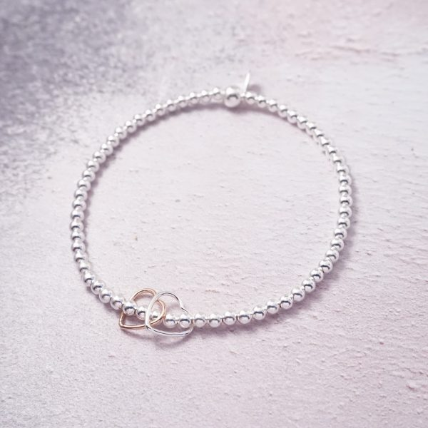 Sterling Silver Stretch Bracelet with Silver and Rose Gold Open Hearts
