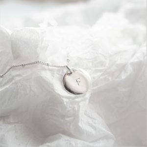 Sterling silver necklace with stamped initial disc
