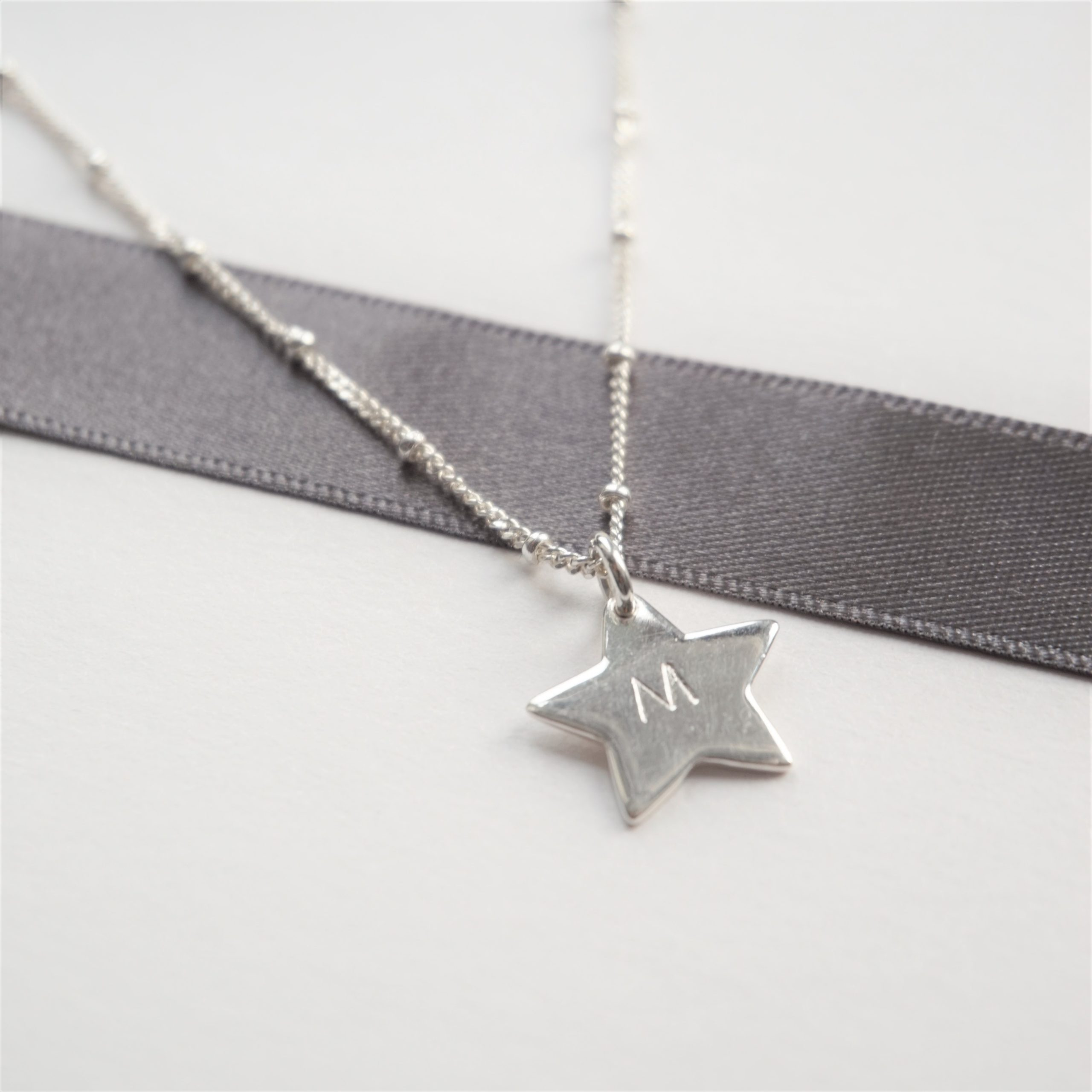 sterling silver necklace with stamped star charm