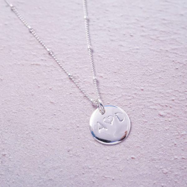 Sterling silver initial duo heart stamped necklace
