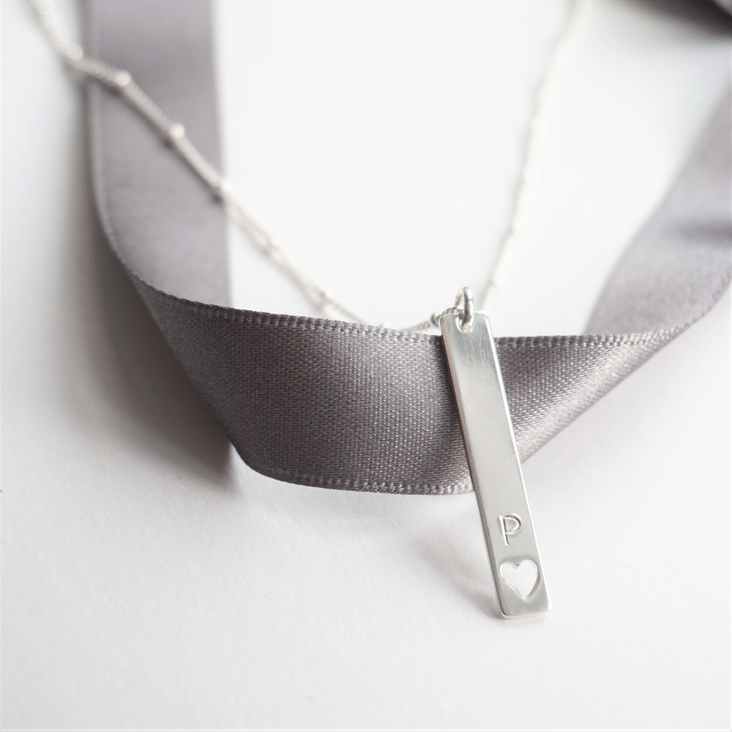 sterling silver necklace with stamped rectangular charm