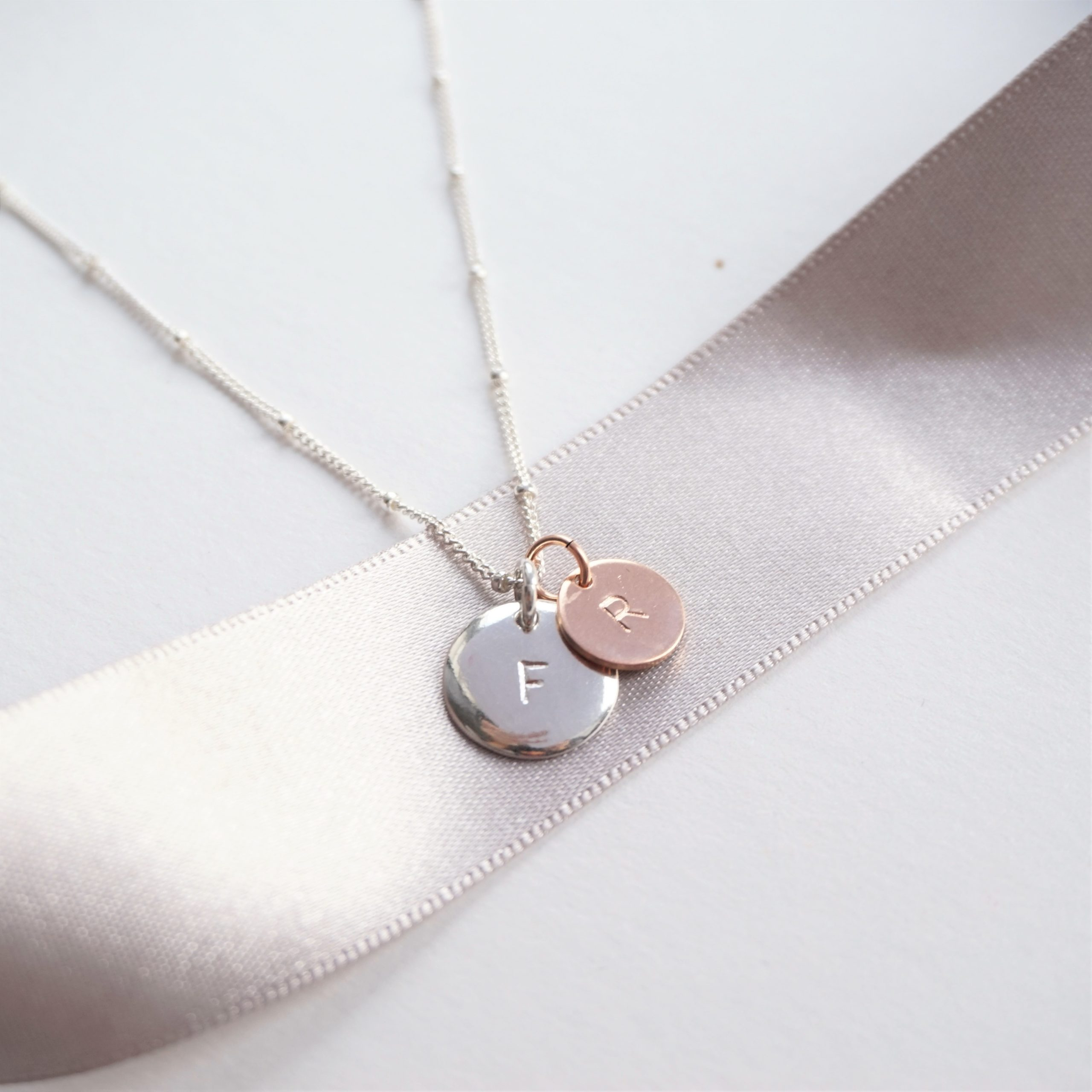 sterling silver necklace with stamped silver and rose gold discs