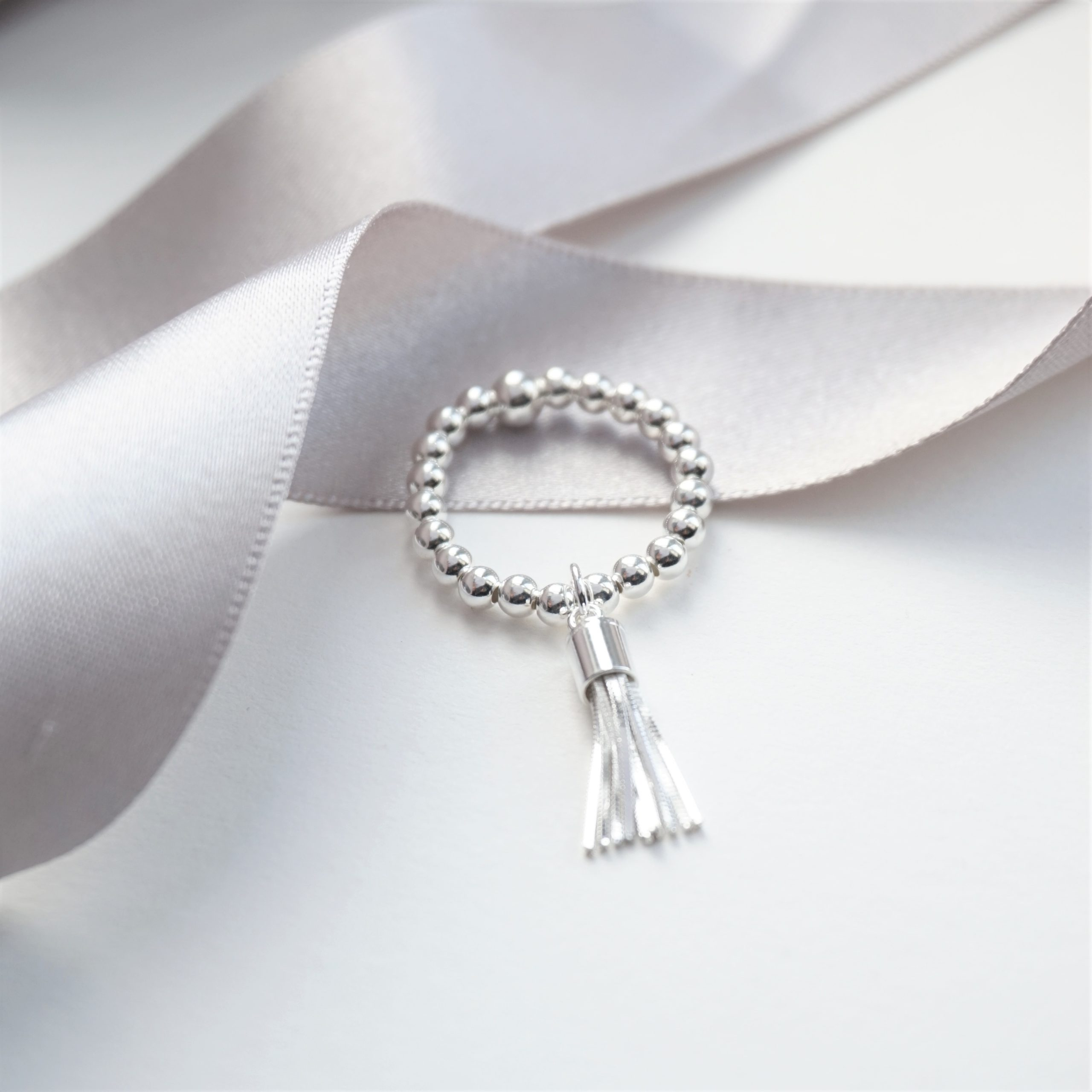 sterling silver ring with tassel charm