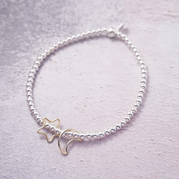 sterling silver and gold star moon stretch bracelet