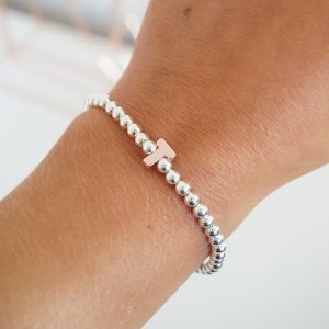 Sterling silver bracelet with rose gold initial
