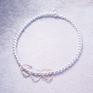 sterling silver rose gold and gold hearts stretch bracelet