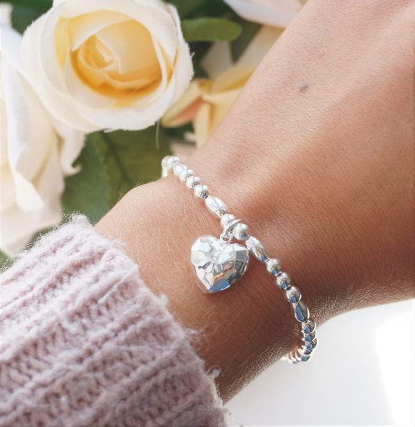 sterling silver bracelet with hammered heart charm