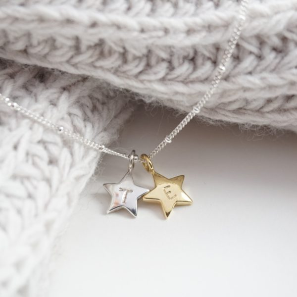 Sterling silver necklace with stamped initial gold and silver star charms
