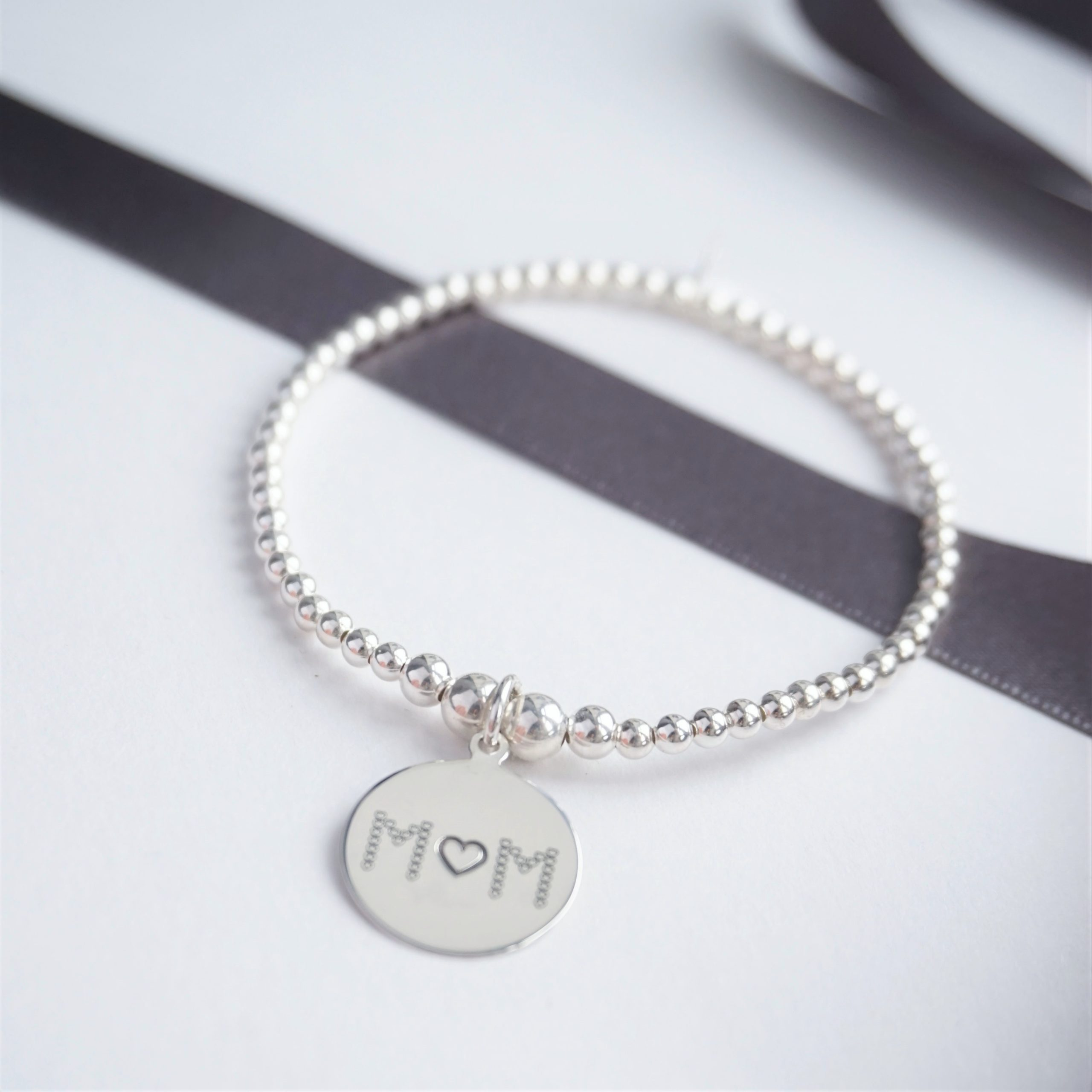 sterling silver bracelet with mum charm