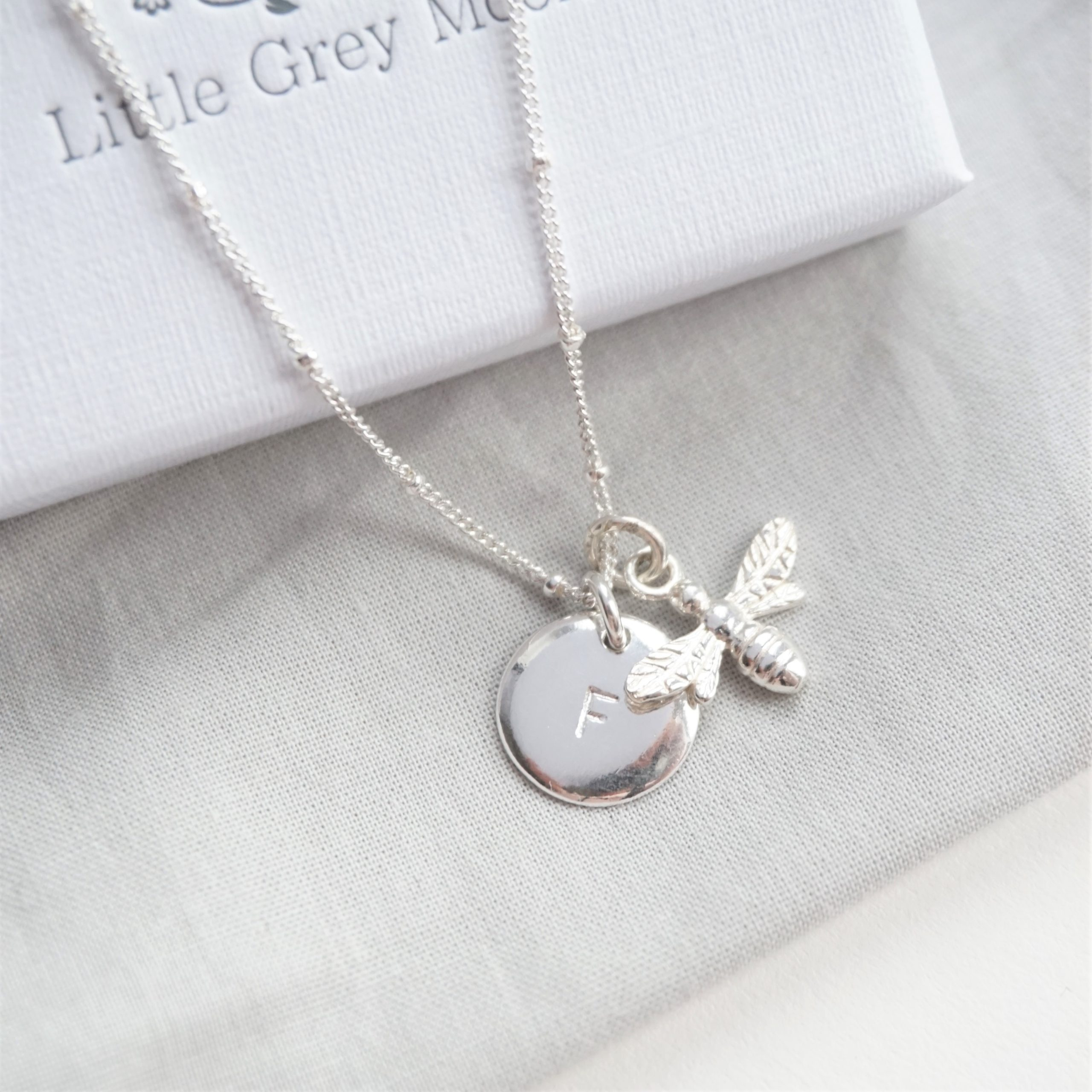 sterling silver stamped disc initial and bee charm