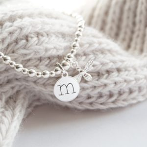 sterling silver bracelet with lowercase initial and bumble bee charm