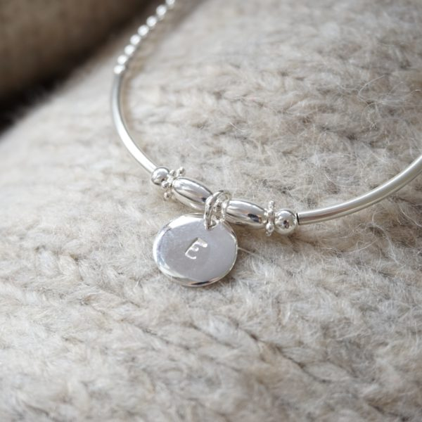sterling silver beaded noodle bracelet with stamped initial disc